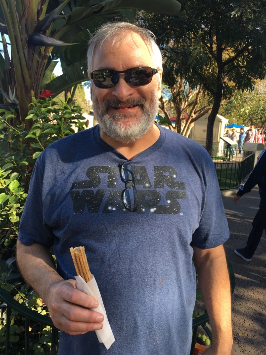 Dad's first Disney churro in years!