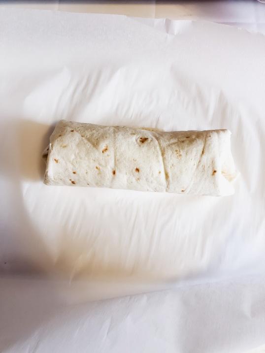 My secret to soft microwavable burritos? Parchment paper.